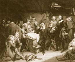 1620年、メイフラワー号の船上で「メイフラワー誓約書」に署名をする  ピルグリム・ファーザーたち(Library of Congress)